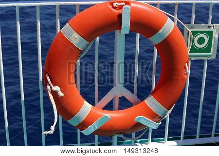Orange Life Buoy On The Deck Of A Cruise Ship