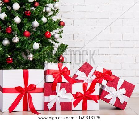 Gifts Under Decorated Christmas Tree With Colorful Balls