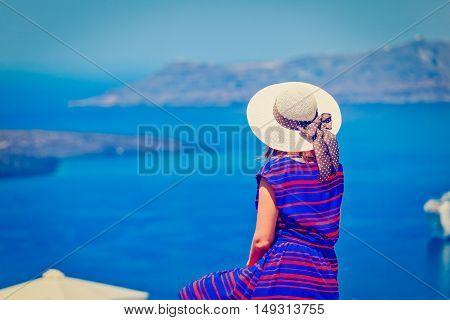 young woman on vacation in Santorini, Greece, travel concept