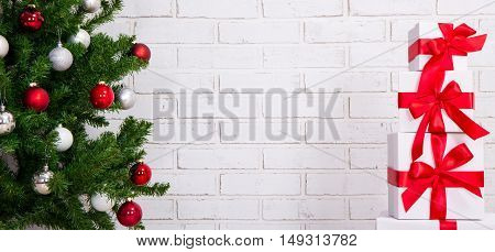 Christmas Background - Gifts And Christmas Tree Over Brick Wall