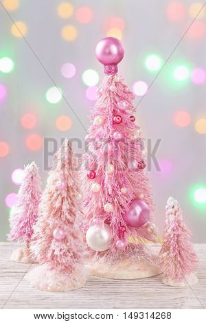 Pastel colored christmas trees and decoration