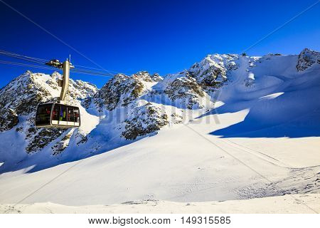 Winter landscape with cable car and lift station on the top of swiss mountains with mont Fort on the background, Verbier, 4 Valleys, Switzerland.