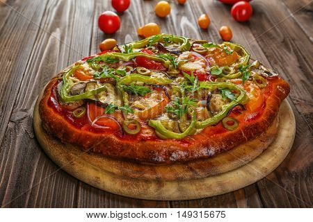 Tasty homemade pizza on table