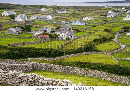 old irish dry stone wall with a field background in county kerry ireland