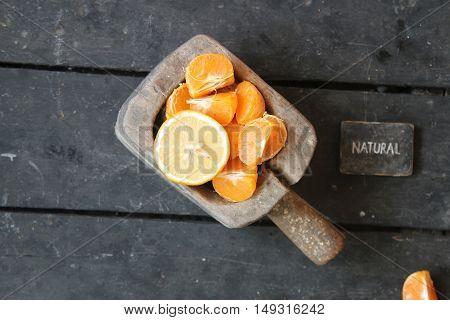 slices of mandarin, lemon and natural text