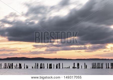 Ruegen island, Long exposure shot of groyne at Jasmunder Bodden in sunset