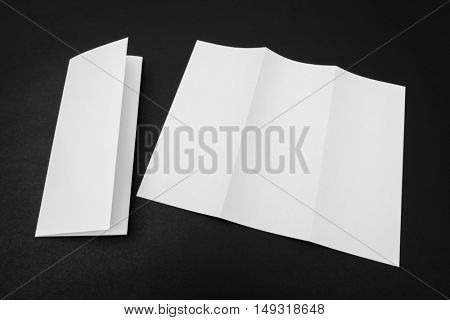 Trifold white template paper on black background