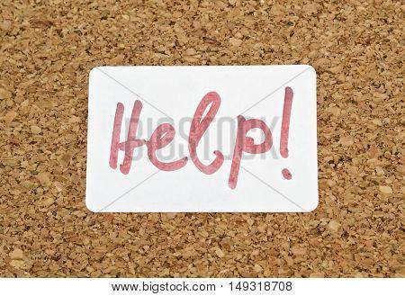 Word Help written on a sticker pinned on a cork board