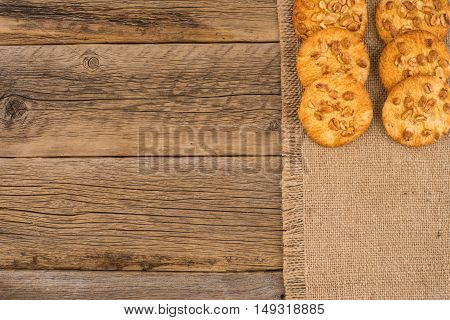 Cookies with peanut on old wooden table. Top view.