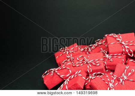 Red gift boxes with rope on black background
