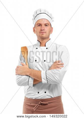 Young chef cook with wooden cutlery isolated on white