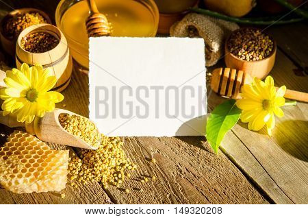 Beekeeping Products On A Wooden Table With Empty Card For You Text . Side View