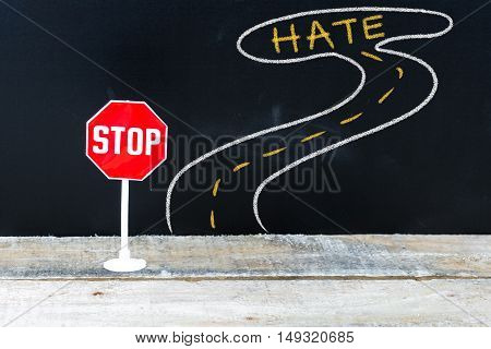 Mini Stop Sign On The Road To Hate
