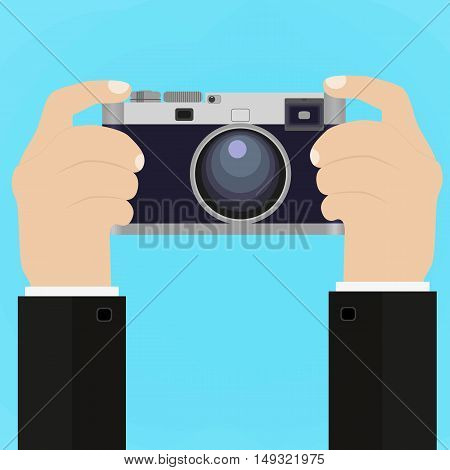 Flat illustration of Retro photo camera with hand holding it. illustration of a hand holding Vintage camera for your design