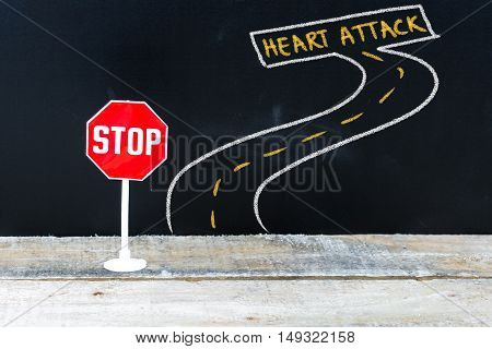 Mini Stop Sign On The Road To Heart Attack