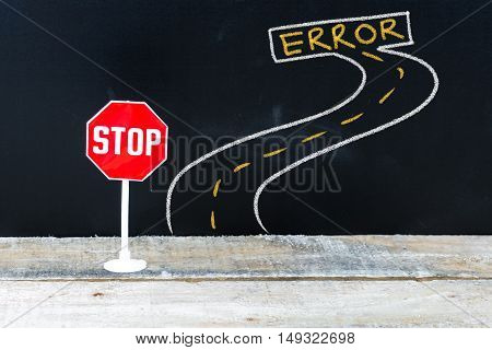 Mini Stop Sign On The Road To Error