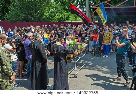 Dnepropetrovsk Ukraine - June 30 2016: Orthodox priests carry the funeral liturgy for deceased Ukrainian baritone singer Paris Opera Vasyl Slipak who was killed during the Russian-Ukrainian war in Donbas
