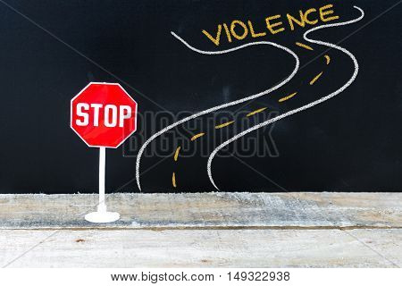 Mini Stop Sign On The Road To Violence