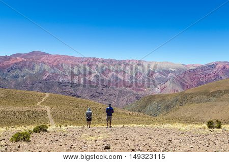 Humahuace, Argentina - November 15, 2015: People admiring the Mountain of fourteen colors in the Northwest of Argentina