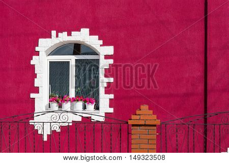 the window of the House in a bright colored exterior pink color