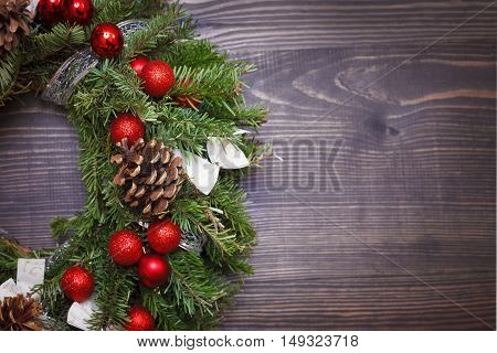 Decorated Christmas wreath close-up on a wooden background