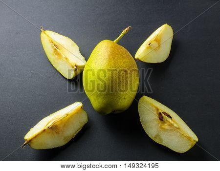 Fresh Organic Green Pear Cut Up Arrangement On Black Background