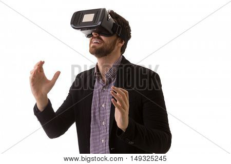 Attractive man with virtual reality glasses isolated on a white background
