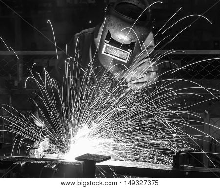 welding work in Industrial automotive part in car production factory. black white