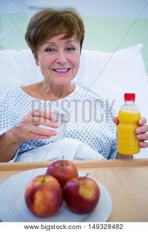 Portrait of smiling patient having a breakfast in hospital