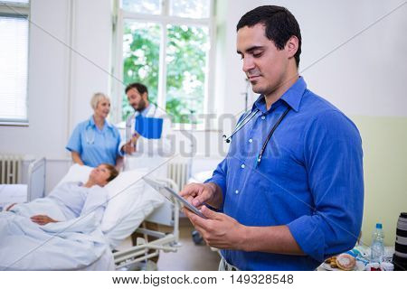 Confident doctor using digital tablet in hospital