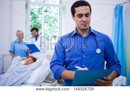 Doctor checking a medical report in hospital