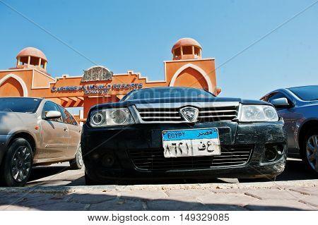 Hurghada, Egypt -20 August 2016: Proton Car With Egypt License Plate Near Luxury Resort Caribbean Wo