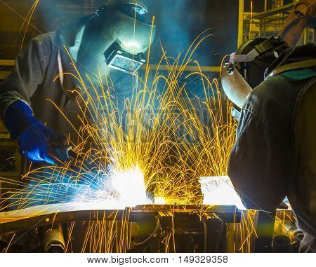 welder welding  Industrial automotive part in car production factory with fire spark
