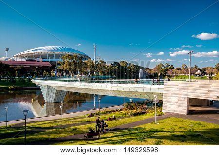 Adelaide Australia - September 11 2016: Adelaide Oval and foot bridge viewed across Elder Park on a bright day