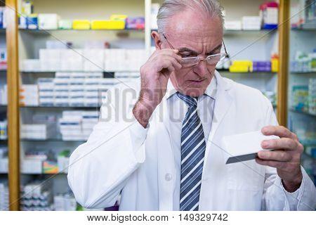 Pharmacist checking medicines in pharmacy