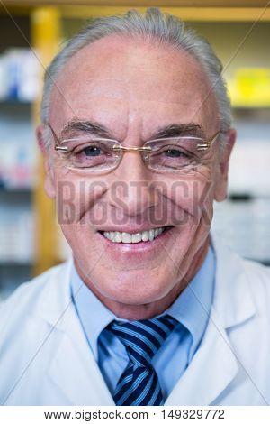 Portrait of pharmacist smiling in pharmacy