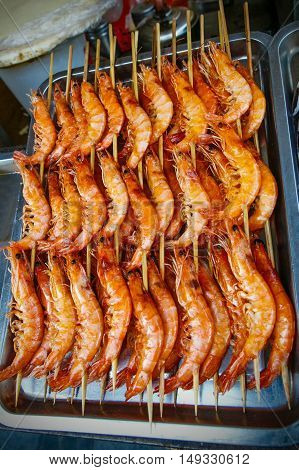 shrimp on a stick - the local refreshment specialities in china market in beijing