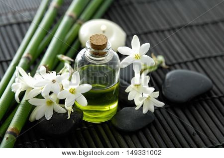 Spa setting with flower, grove, oil ,stones,candle