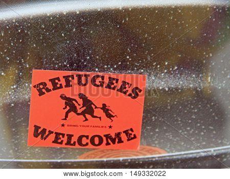 Maribor Slovenia - November 15 2015: sticker 'Refugees welcome' on the window of building in Maribor Slovenia
