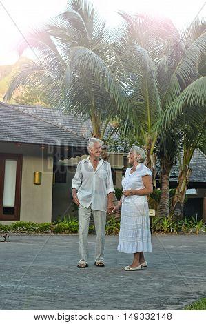 Happy elderly couple   in tropical garden outdoor