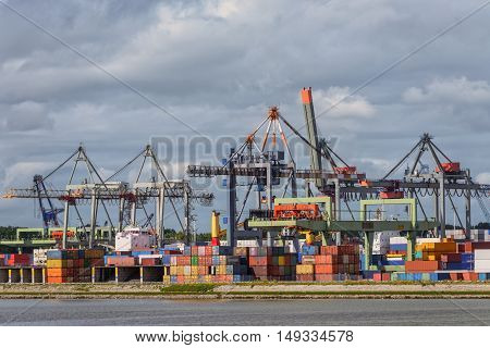 Large cargo dock with cranes and vessels