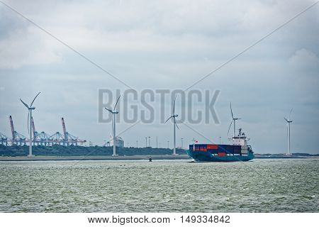 Large container ship leaving dock with heavy weight
