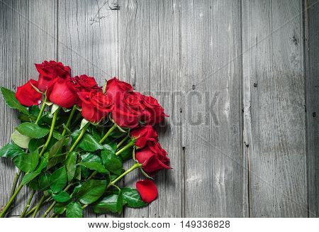 Dozen Red Roses on Wood Background / Proposal/ top view, copy space