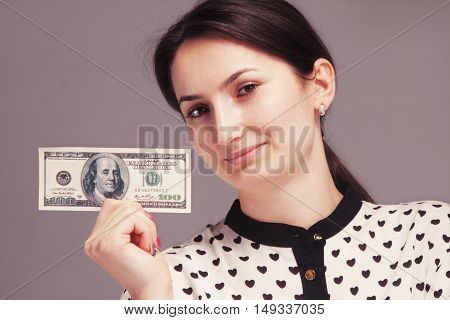 Happy young sucessful woman showing money (Happy self-sufficient rich)