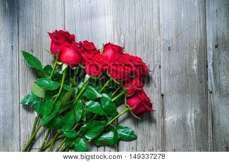 Dozen Red Roses on Wood Background / Proposal/ top view, toning