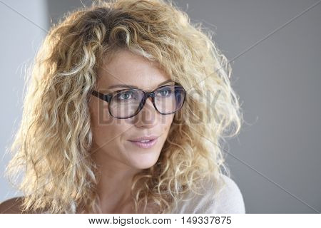 Portrait of attractive blond woman with eyeglasses, isolated