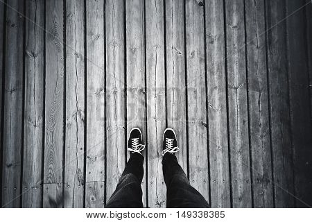 Man standing on the old wooden floor. Travel concept.