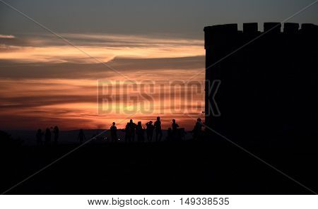 Barack tower at La Perouse (Sydney NSW Australia). People resting at the tower and watching the sunset.
