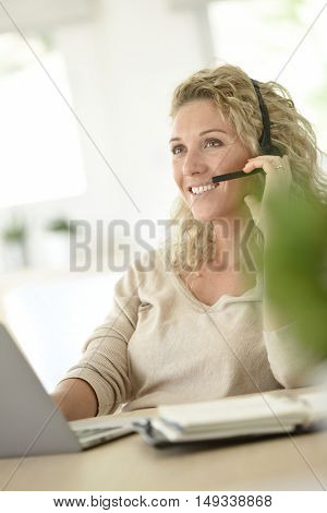 Woman working from home-office, telework