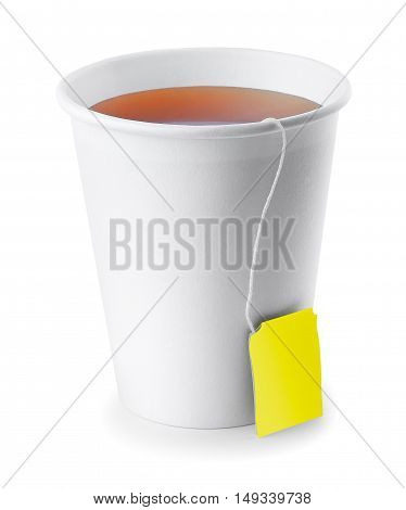 black tea in take away cup isolated on white background. Opened take-out paper cup of tea isolated on white. Black tea. Take-out teacup with tea and yellow label isolated on white